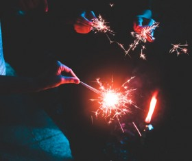 hands cheering with fireworks candles Stock Photo
