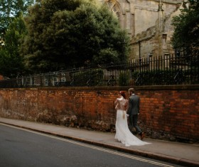 marriage couple walking on pavement Stock Photo