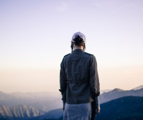 woman standing on high mountain Stock Photo