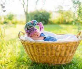 A baby sleeping in a wicker basket Stock Photo (2)