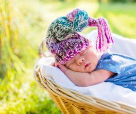 A baby sleeping in a wicker basket Stock Photo (3)