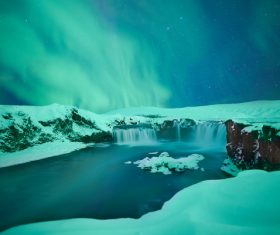 Amazing snowy waterfall landscape at dusk Stock Photo