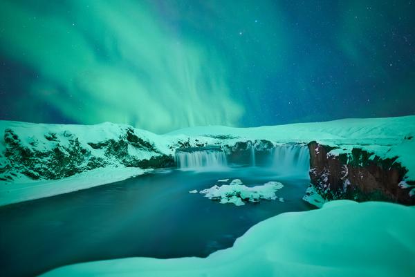 Amazing snowy waterfall landscape at dusk Stock Photo