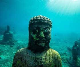 Ancient stone buddha statues under sea Stock Photo