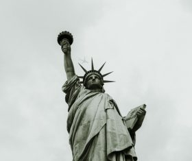Artistic liberty statue under sky Stock Photo