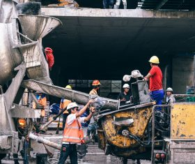 Asian workers on busy construction site Stock Photo