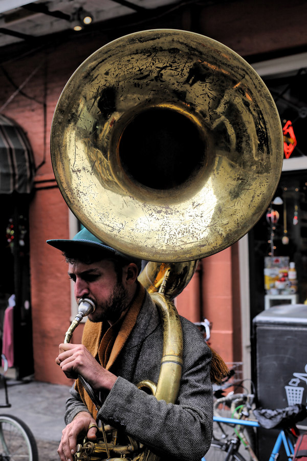 Bearded man performing with big trumpet on road Stock Photo