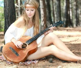 Beautiful girl holding old guitar Stock Photo