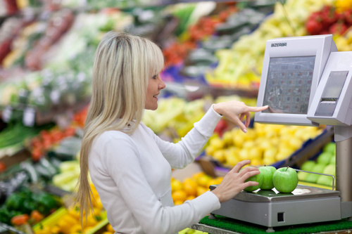 Beautiful housewife buying food in supermarket Stock Photo 01
