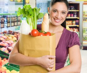 Beautiful housewife buying food in supermarket Stock Photo 02