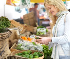 Beautiful housewife buying food in supermarket Stock Photo 03