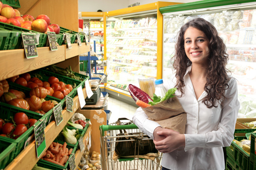 Beautiful housewife buying food in supermarket Stock Photo 04