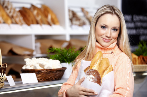 Beautiful housewife buying food in supermarket Stock Photo 05