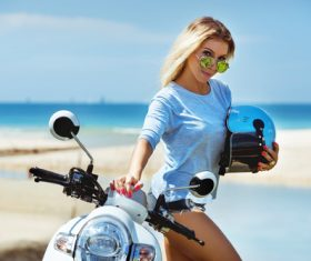 Beautiful woman and scooter Stock Photo