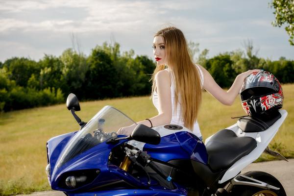 Beautiful woman sitting on motorbike posing Stock Photo 02