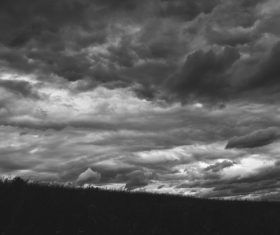 Black white picture of cloudy sky at dusk Stock Photo