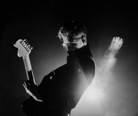 Black white picture of guitarist excited on stage Stock Photo
