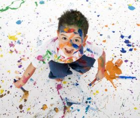 Boy from tip to toe paint with an oil Stock Photo 05