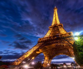Bright Eiffel Tower at night Stock Photo 02