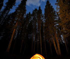 Bright camping tent at night Stock Photo
