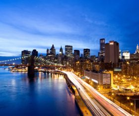 Brightly lit city and bridge Stock Photo 02