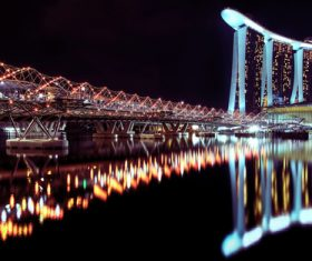 Brightly lit city and bridge Stock Photo 03