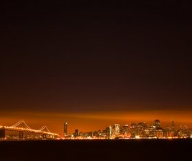 Brightly lit city and bridge Stock Photo 04