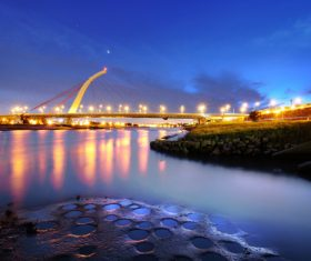 Brightly lit city and bridge Stock Photo 05