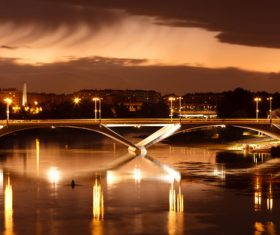Brightly lit city and bridge Stock Photo 06