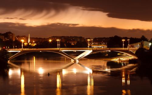 Brightly lit city and bridge Stock Photo 06
