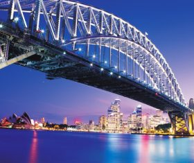 Brightly lit city and bridge Stock Photo 08