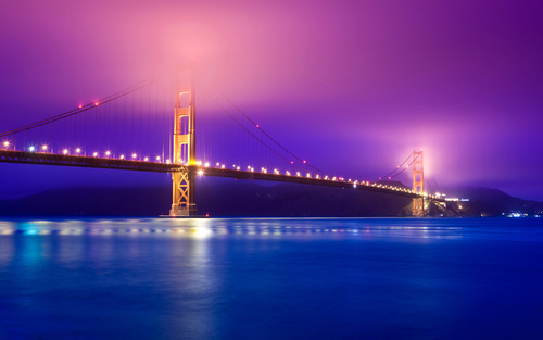 Brightly lit city and bridge Stock Photo 09