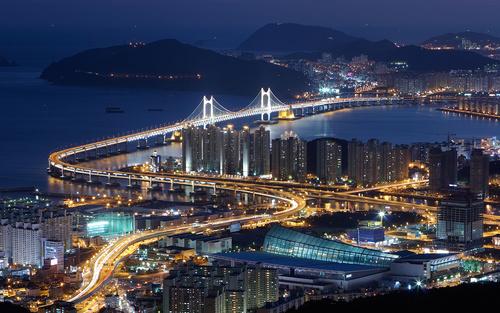 Brightly lit city and bridge Stock Photo 10