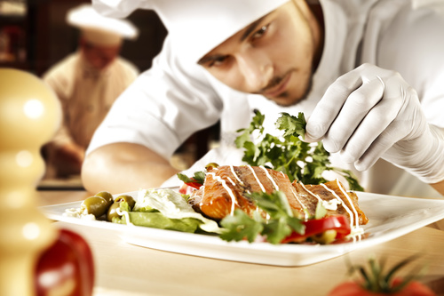Chef decorating dishes Stock Photo