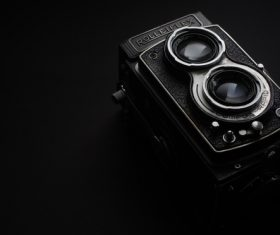 Closeup vintage camera in darkness Stock Photo