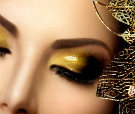 Closeup woman golden eye shadow Stock Photo