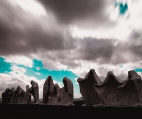 Cloudscape above artistic rocky shaped statues Stock Photo