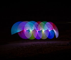Colorful lights circles in darkness Stock Photo