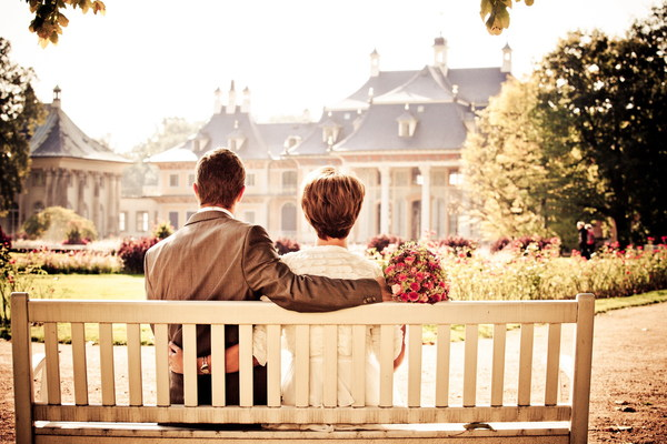Couple sitting on a bench Stock Photo