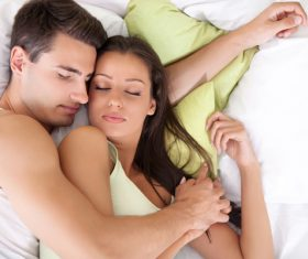 Couple sleep in each others arms Stock Photo 01