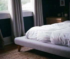 Cozy empty bedroom Stock Photo