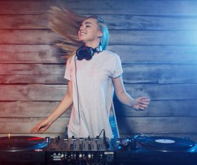 DJ girl swings with music Stock Photo 01