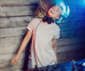 DJ girl swings with music Stock Photo 02