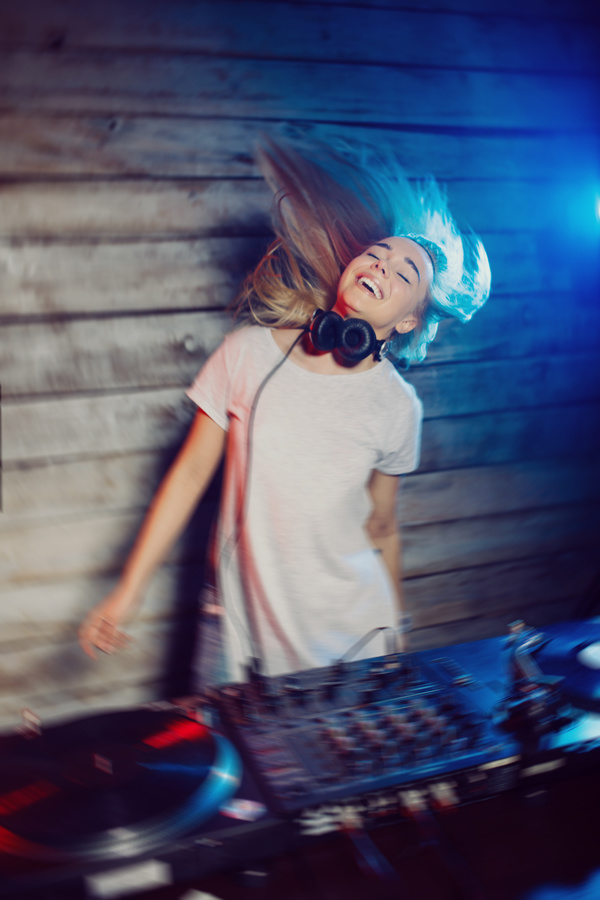 DJ girl swings with music Stock Photo 02