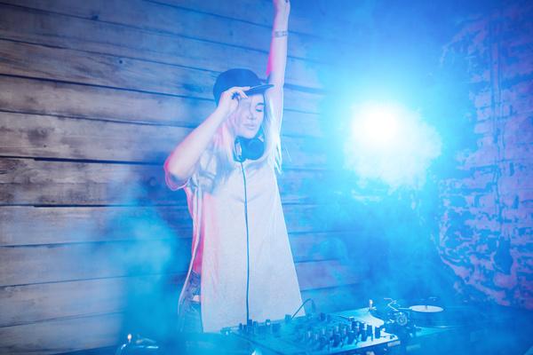 DJ girl swings with music Stock Photo 03