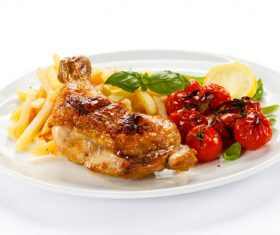 Delicious French fries and roasted chicken legs Stock Photo