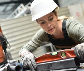 Female worker using balancer Stock Photo