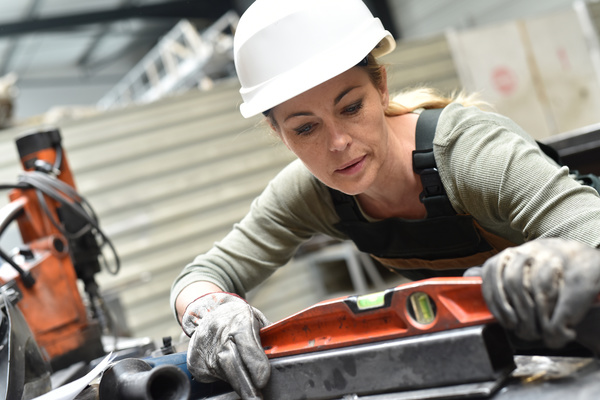 Female worker using balancer Stock Photo