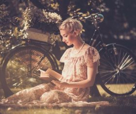 Girl with a bicycle resting in the bosom of nature Stock Photo (1)
