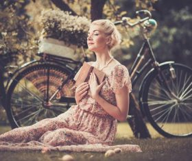Girl with a bicycle resting in the bosom of nature Stock Photo (2)
